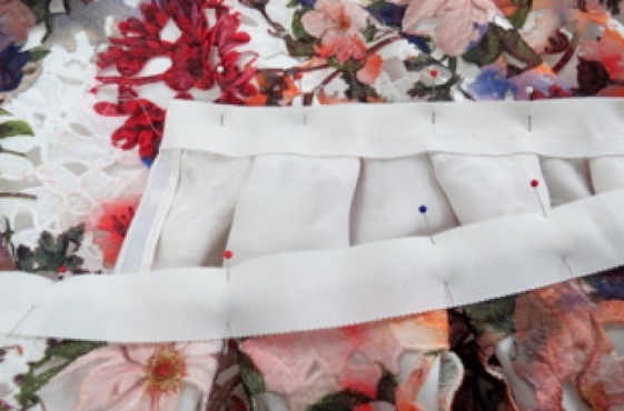 Pin the second layer of Petersham to the outside of the skirt, aligning the top edges of the waistband.